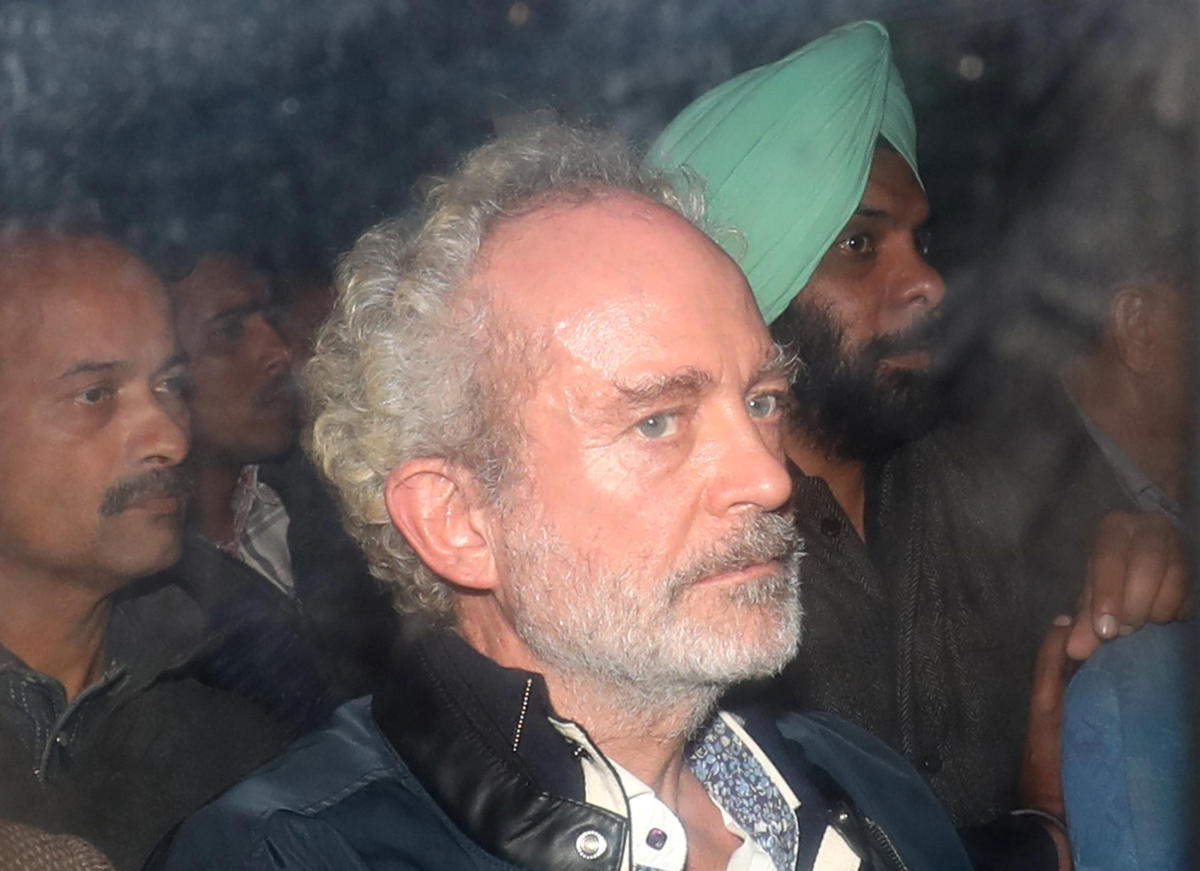Christian Michel inside a police vehicle outside a court in New Delhi on Wednesday. REUTERS/Anushree Fadnavis