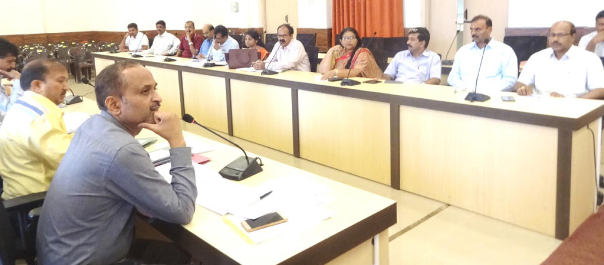 Officials take part in the tourism development committee meeting in the deputy commissioner's office in Madikeri on Thursday.