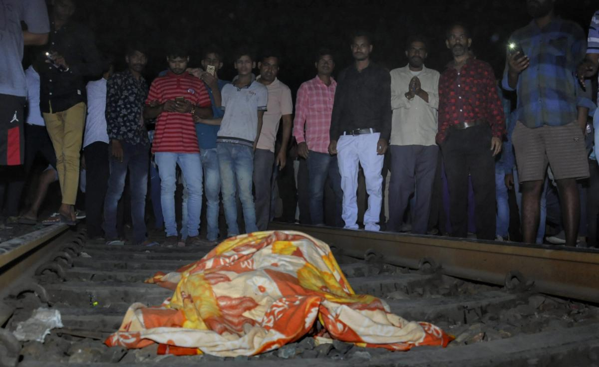 People gather near the body of a victim at the site of a train accident at Joda Phatak in Amritsar, Friday, Oct 19, 2018. Officials said at least 60 bodies have been found and many more injured have been admitted to a government hospital after the accident near the site of Dussehra festivities. (PTI Photo)