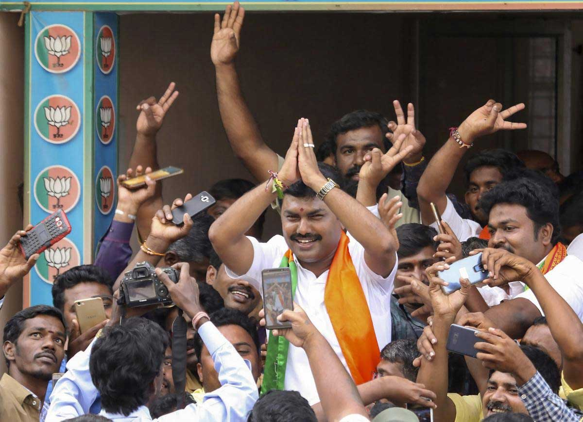 BJP candidate BY Raghavendra celebrates his victory in the Shimoga Lok Sabha by-poll, in Shivamogga, Karnataka, Tuesday, Nov. 6, 2018. (PTI Photo)