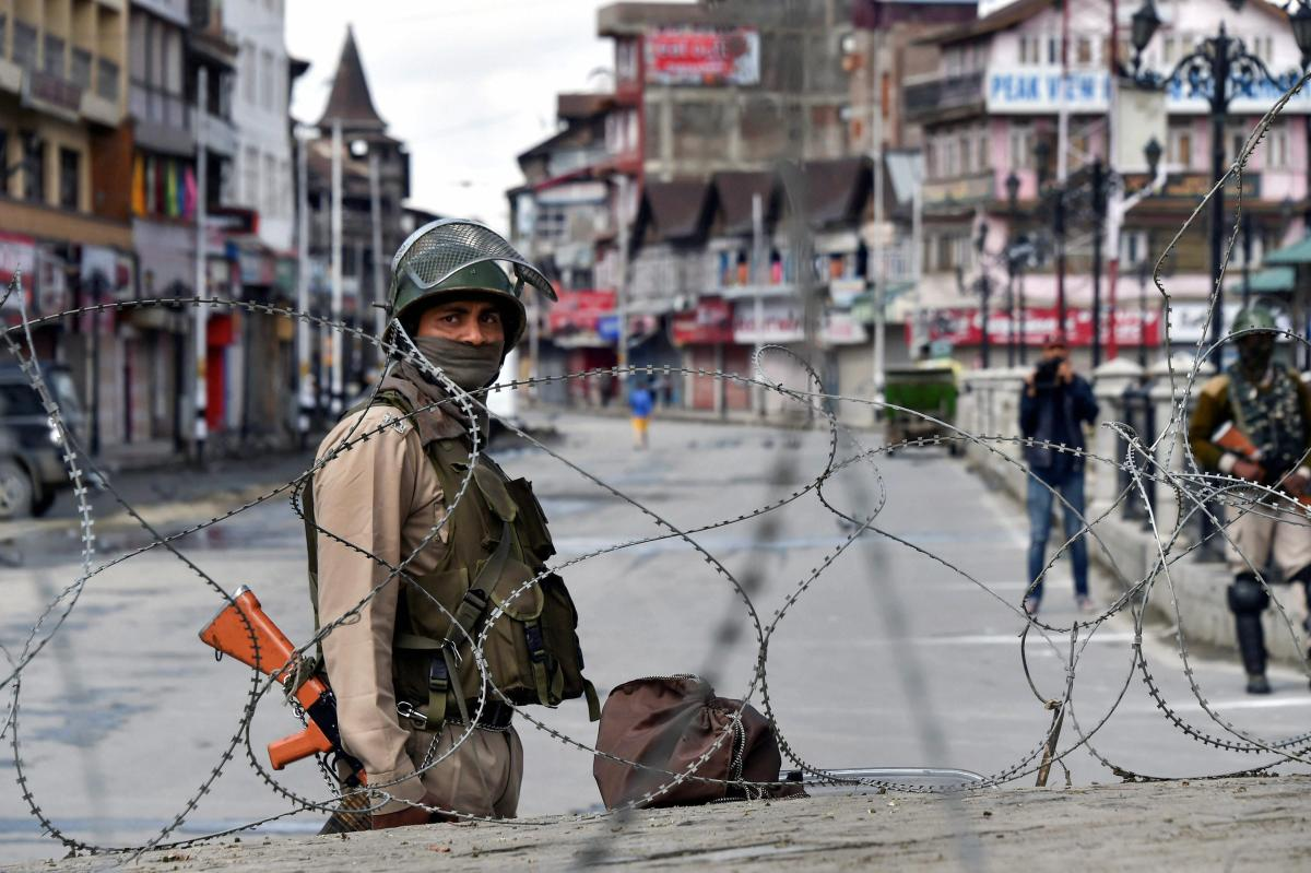 Srinagar: A security person stands guard during restrictions and strike called by separatists against Prime Minister Narendra Modi's visit to the state, at Lal Chowk, in Srinagar, on Saturday. (PTI Photo/S Irfan) (PTI5_19_2018_000048A)