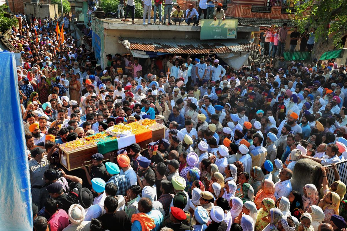 The mortal remains of Rifleman Vikram Jit Singh, who was killed while foiling an infiltration bid in Jammu and Kashmir, being brought to his native village of Tepla for his last rites, in Ambala on Thursday. PTI