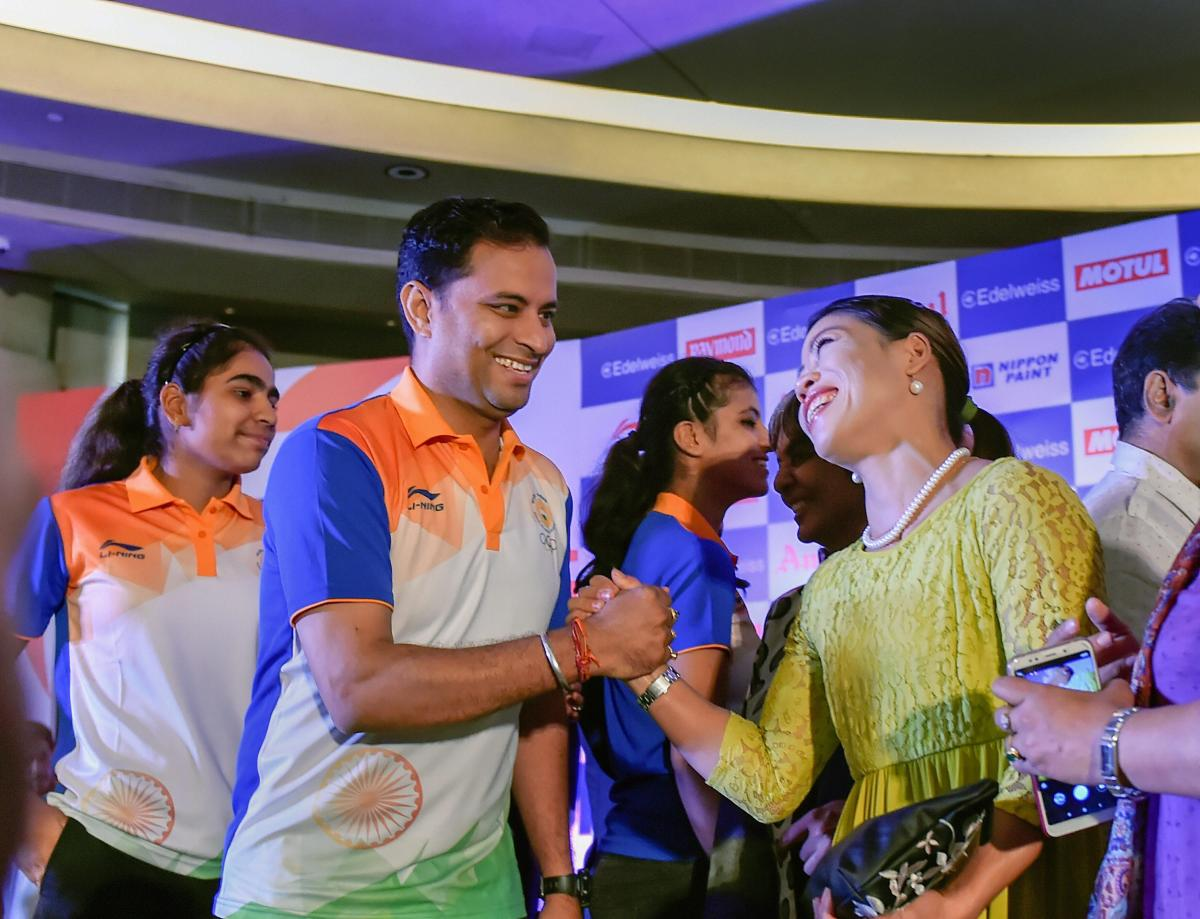 Shooter Sanjeev Rajput (left) and boxer Mary Kom during the Asian Games 2018 send-off ceremony in New Delhi on Friday. PTI