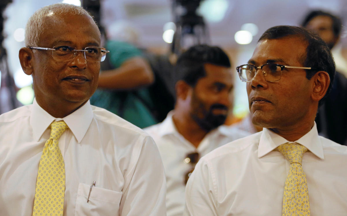 Maldivian joint opposition presidential candidate Ibrahim Mohamed Solih (left) looks on next to Maldives' former president Mohamed Nasheed at a campaign for the September 23 Presidential election where thousands of eligible Maldivians live, in Colombo, Sr