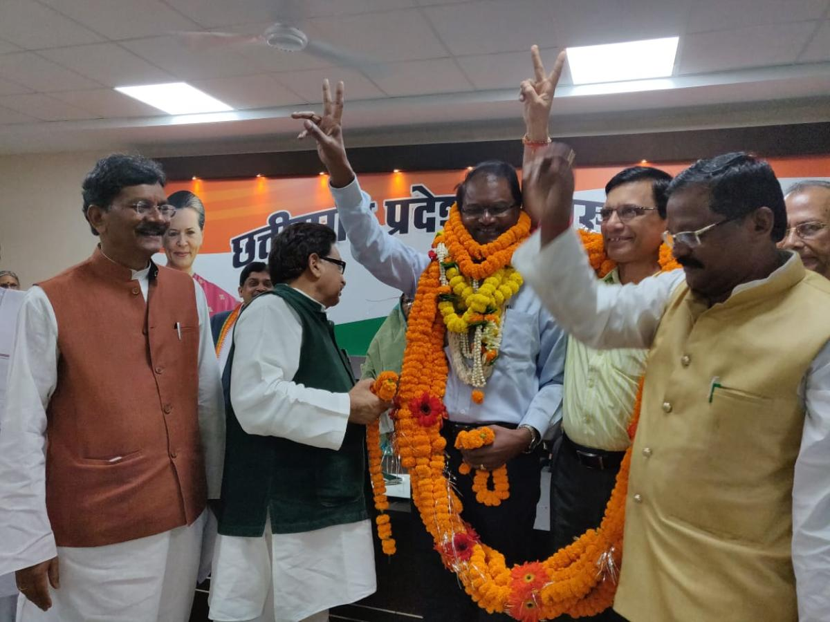 Serjius Minj, along with R P S Tyagi, being garlanded in presence of Congress leaders after he took the primary membership of the party on Sunday in Raipur.