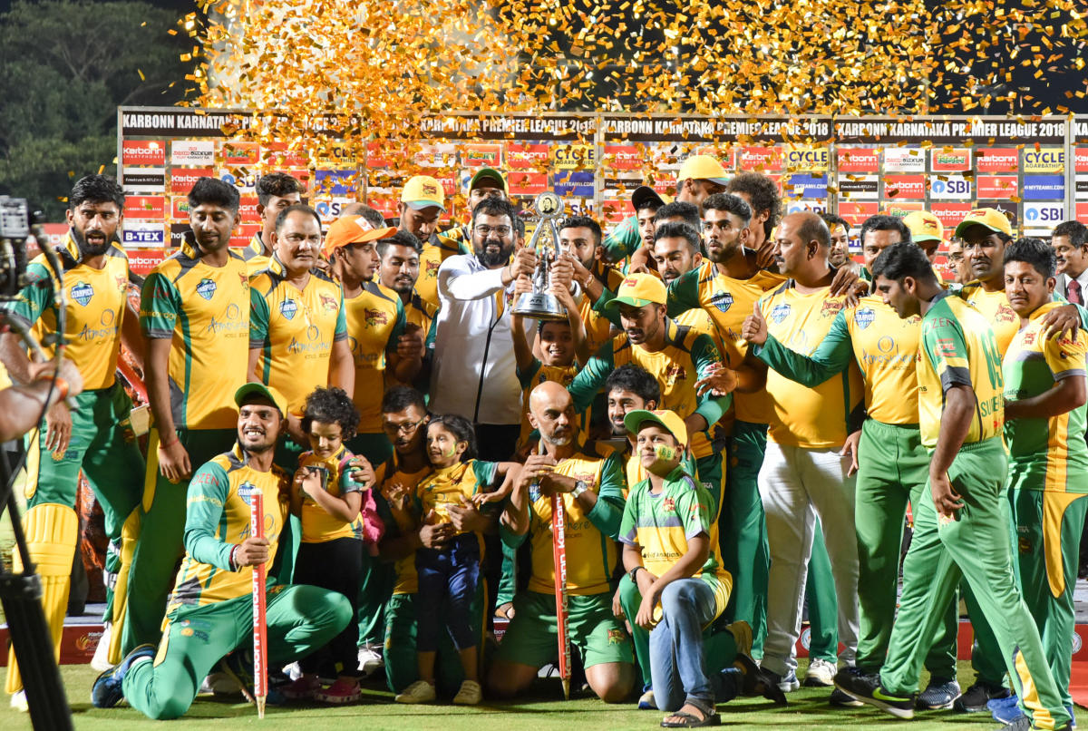 Triumphant: Bijapur Bulls celebrate with the KPL trophy at SDNRW stadium in Mysuru on Thursday. DH PHOTO/ SAVITHA B R
