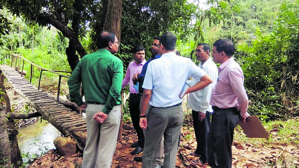 The Central team members inspect a footbridge in rain-affected areas in Udupi on Wednesday.