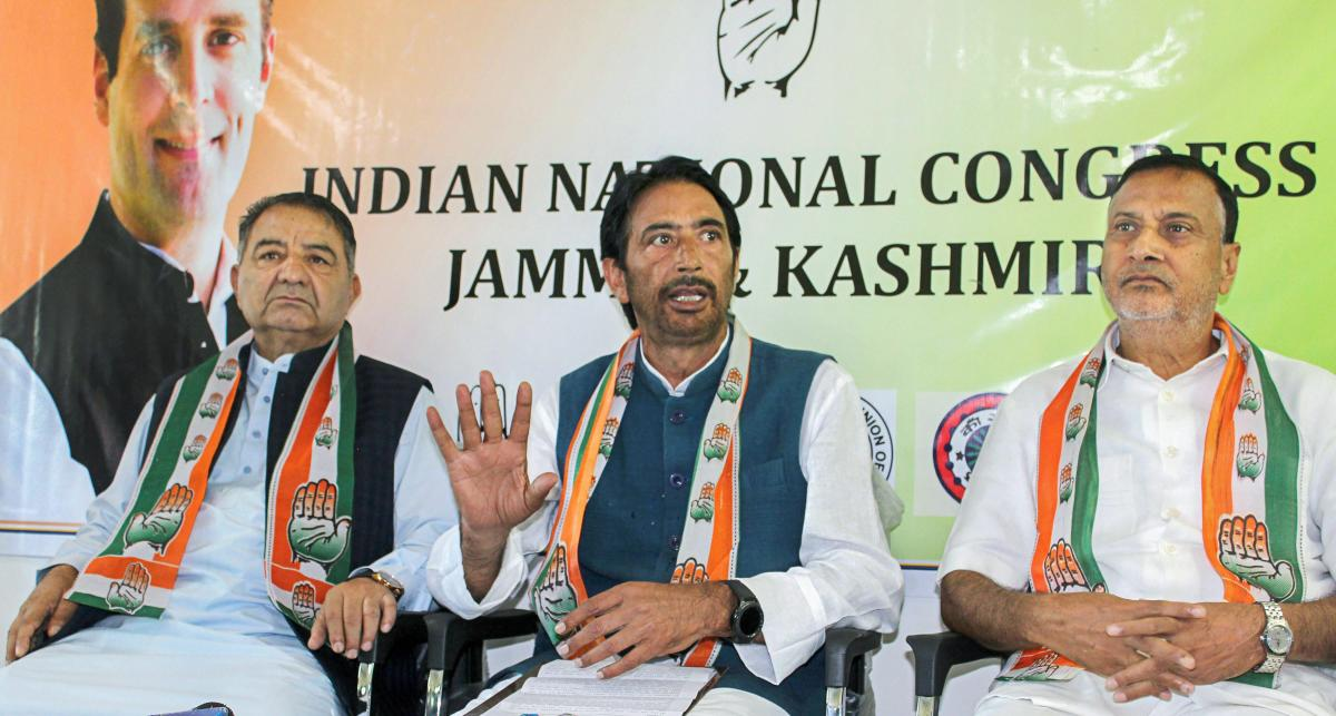 State Congress Chief Ghulam Ahmad Mir (C) addresses a press conference regarding elections, in Srinagar on Wednesday. Congress Party has decided to contest upcoming elections while National Conference and Peoples Democratic Party have boycotted. PTI