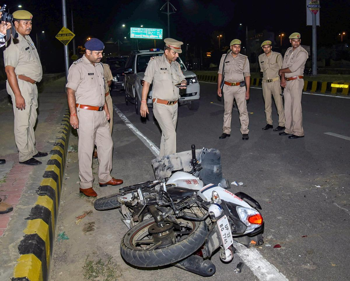 Police personnel conduct investigation near the bike of the constable responsible for shooting an Apple employee, on patrol duty, in Lucknow, on September 29. Tiwari was shot dead after he allegedly refused to stop his car for checking in the posh Gomti N