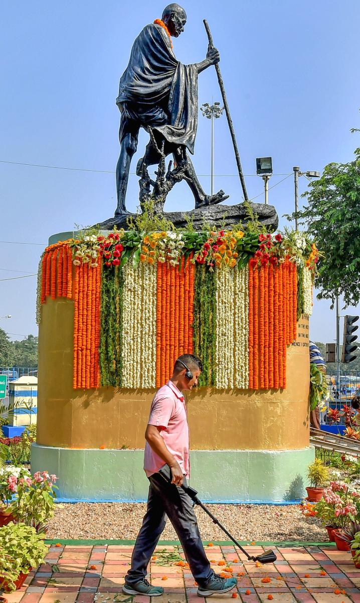 A security person inspects the area surrounding the Gandhi statue during the 149th birth anniversary of Mahatma Gandhi in Kolkata on October 2, 2018. PTI