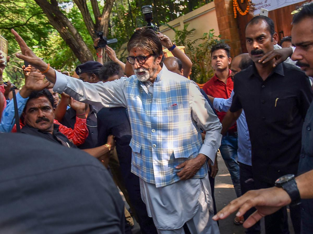 Bollywood actor Amitabh Bachchan greets fans who had gathered outside his bungalow on his 76th birthday, in Mumbai on Thursday. PTI