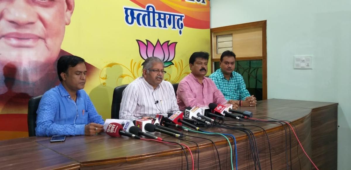 BJP Chhattisgarh president Dharamlal Kaushik addressing reporters.