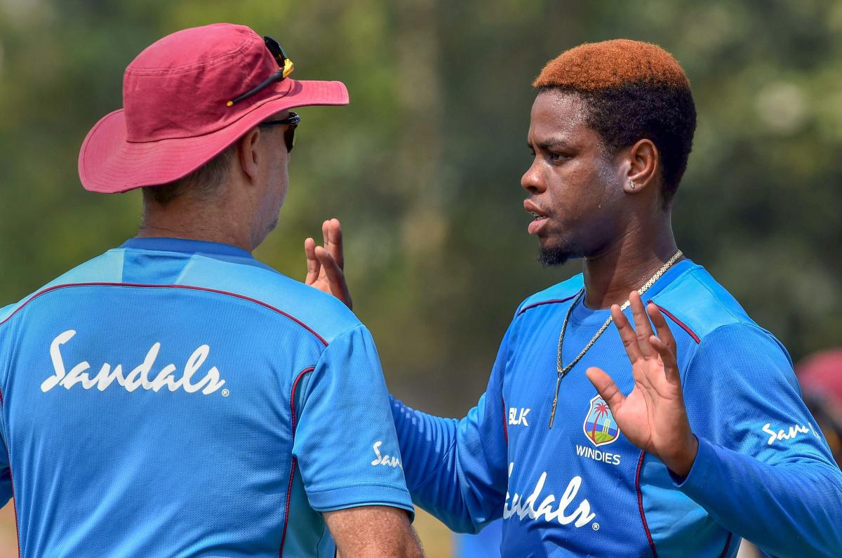 West Indies batsman Shimron Hetmyer (right) discusses with coach Stuart Law on the eve of the second ODI against India in Visakhapatnam on Tuesday. PTI