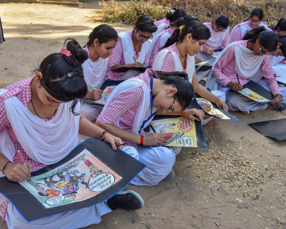 Students participate in a competition on making political posters during an election awareness campaign, in Bikaner, on Tuesday. PTI