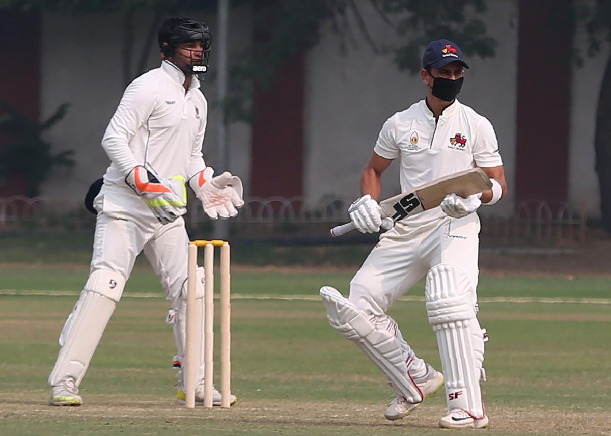 Mumbai's Siddesh Lad bats with a mask to fight Delhi's smog on the first day of the Ranji Trophy match against Railways in Delhi on Thursday. AFP