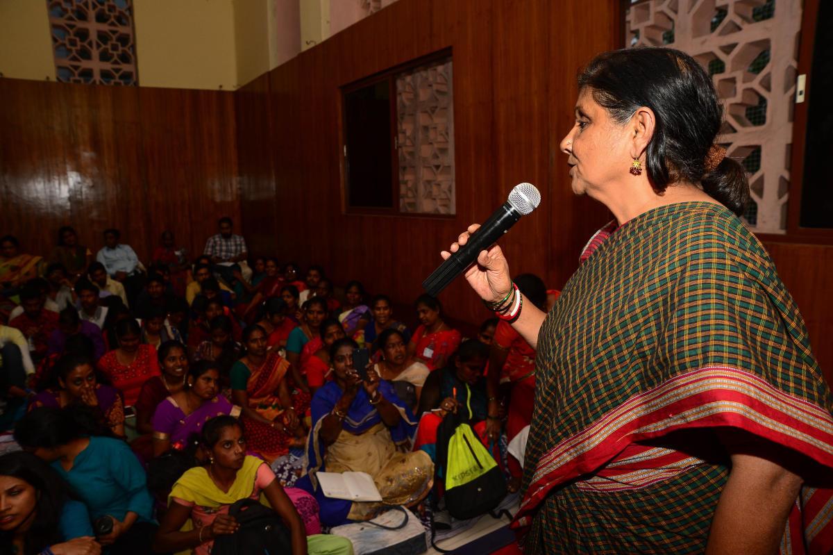 Activist Geeta Menon addresses garment and municipal workers at a #MeToo dialogue at the Kannada Bhavan in Bengaluru on Saturday. DH PHOTO