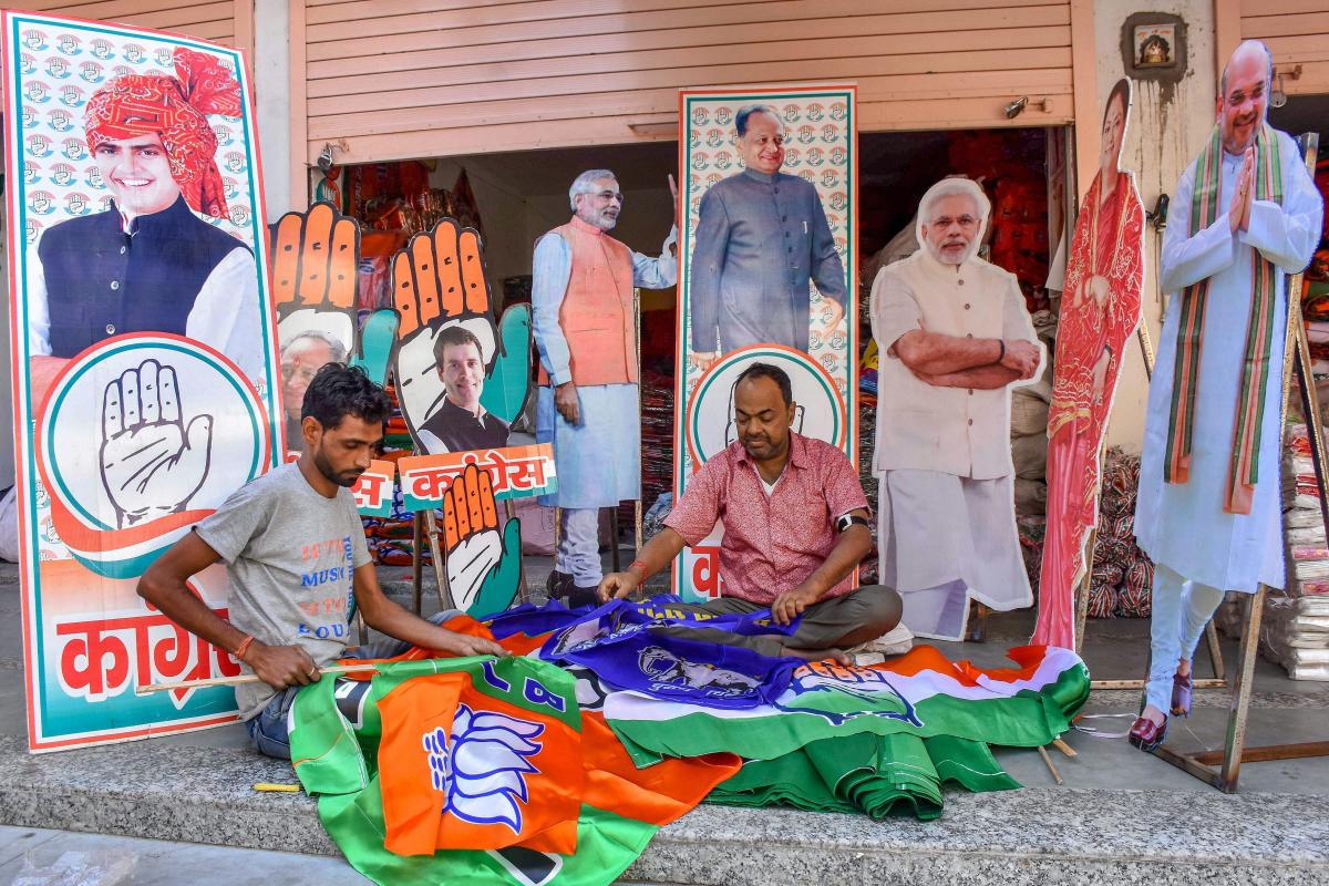 Workers prepare promotional materials for BJP and Congress ahead of the Rajasthan Assembly Elections, at Tripolia Bazaar in Jaipur, Wednesday, Nov. 14, 2018. (PTI Photo)