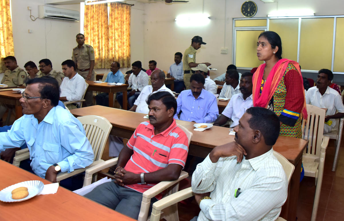 A woman raises a point during the SC/ST grievances meeting organised under the chairmanship of Superintendent of Police Dr Ravikanthe Gowda.