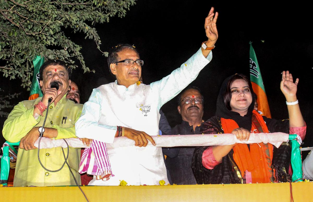 Madhya Pradesh Chief Minister Shivraj Singh Chouhan at a roadshow in support of BJP candidate from Bhopal North assembly constitutency Fatima Rasool Siddiqui (R) for State Assembly election, in Bhopal. PTI Photo