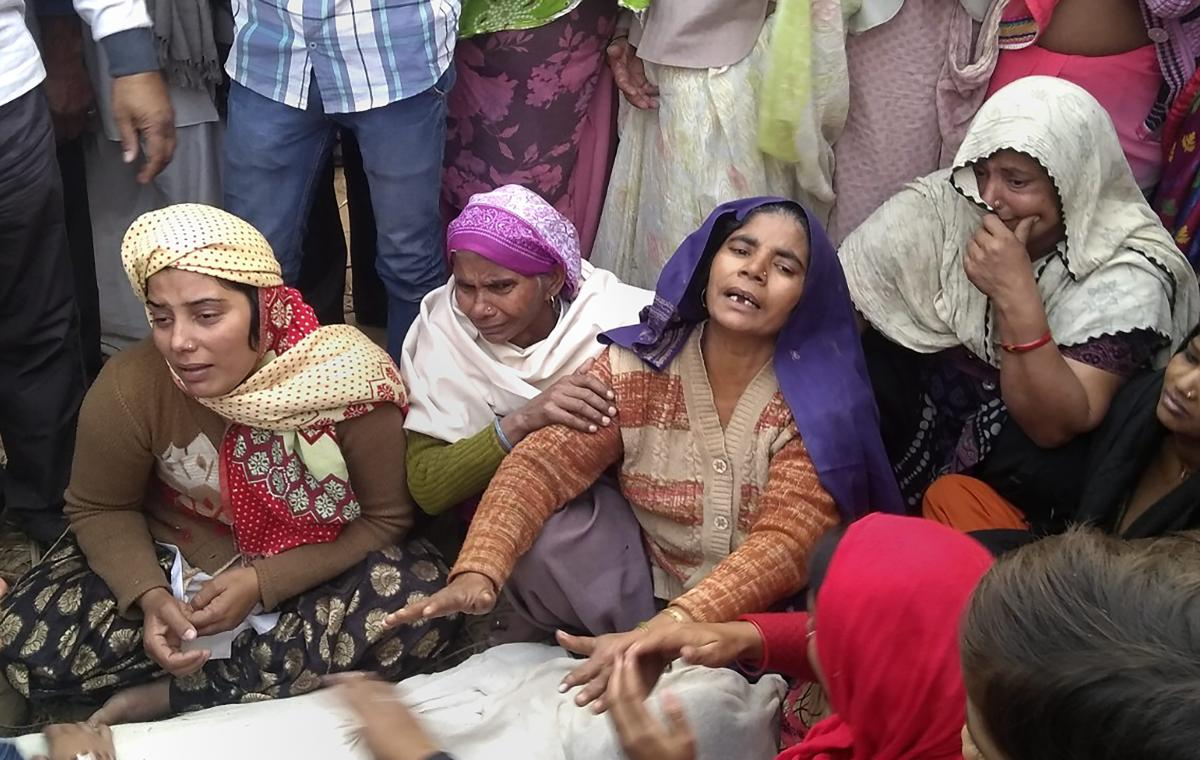 Family members mourn near the body of 20-yr old Sumit Kumar, who was killed in Monday's mob violence, at their village Chingrawati, in Bulandshahr, on Tuesday. PTI