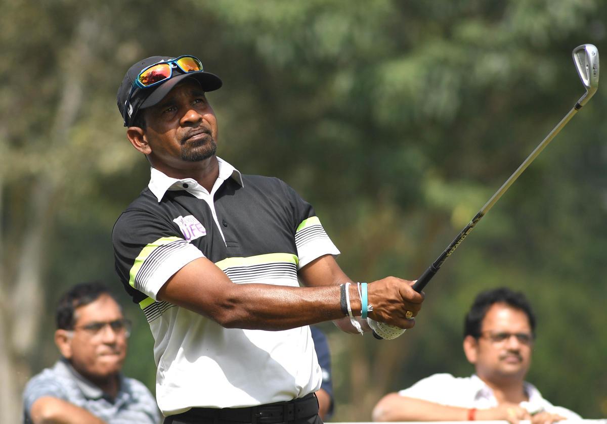 ROCK STEADY: Sri Lanka's Anura Rohana watches his tee shot during the third round of the Bengaluru Open on Saturday. DH PHOTO/ SRIKANTA SHARMA R