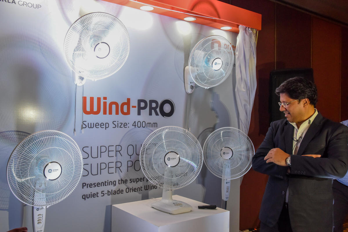 Atul Jain presents Orient's new Wind-Pro portable fan series in Bengaluru on Wednesday. DH Photo