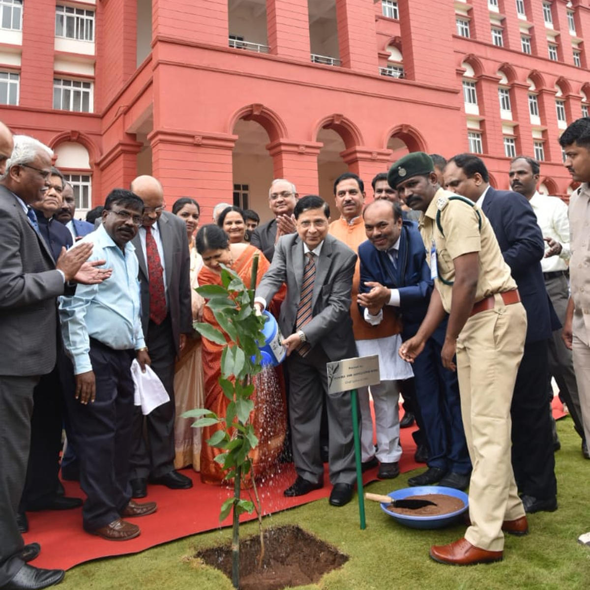 Chief Justice of India Dipak Misra waters a plant during the inauguration of the new court complex in Hubballi on Sunday. DH Photo