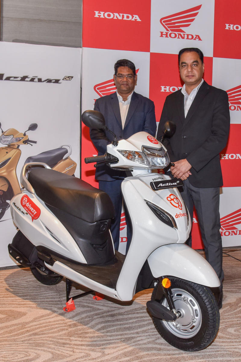 Yogesh Mathur, Head South region, Sales and Yaduvinder Singh Guleria, Senior Vice President, Sales and Marketing, Honda Motorcycle and Scooter India Pvt Ltd are seen at a press conference in Bengaluru on Friday.DH Photo