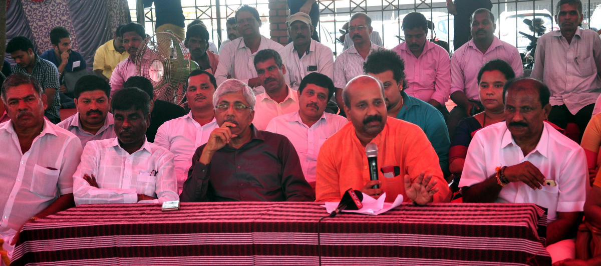 MLA Raghupathi Bhat speaks to reporters in Manipal on Wednesday.
