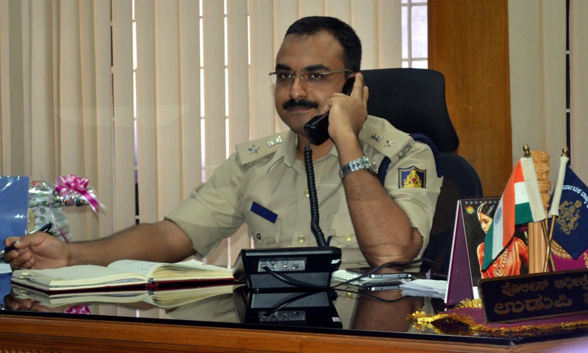 Superintendent of Police Lakshman Nimbargi receives a call during the weekly phone in programme in Udupi on Friday.