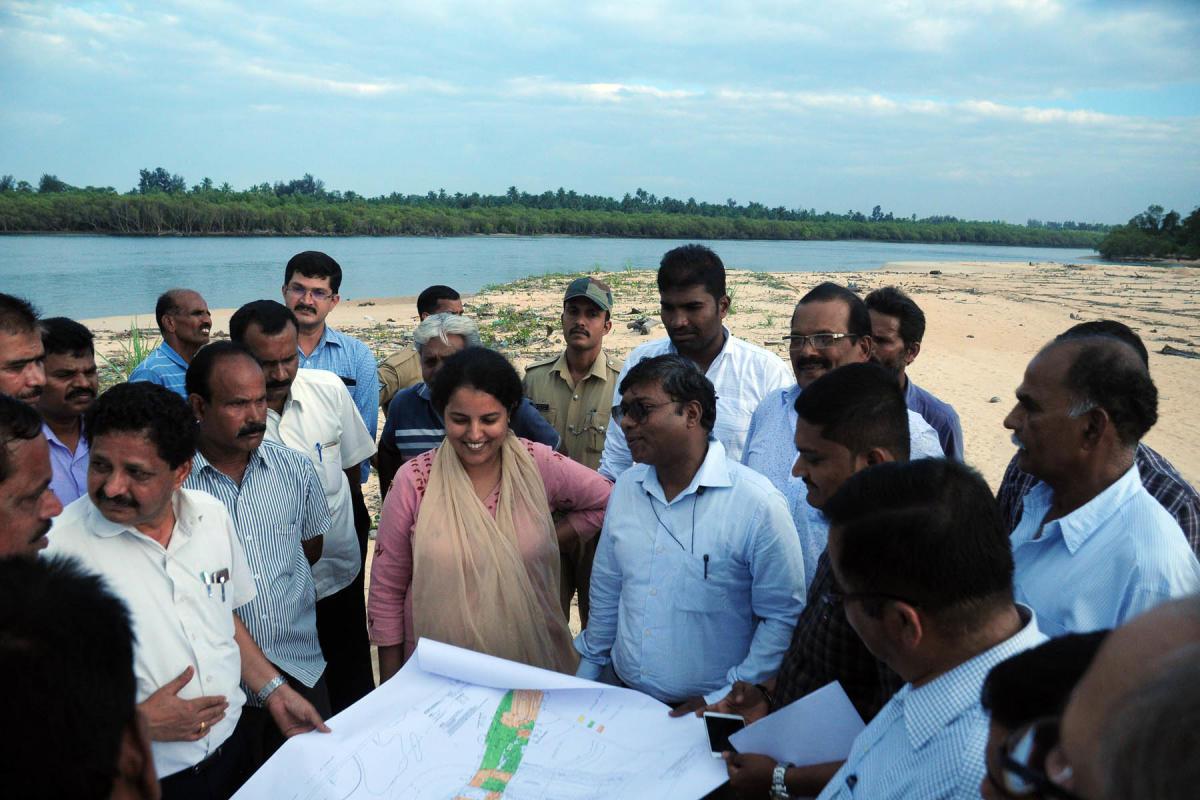 Udupi Deputy Commissioner Priyanka Mary Francis and Dakshina Kannada Deputy Commissioner Sasikanth Senthil speak to fishermen leaders during the inspection of land for the construction of proposed port at Hejamady.