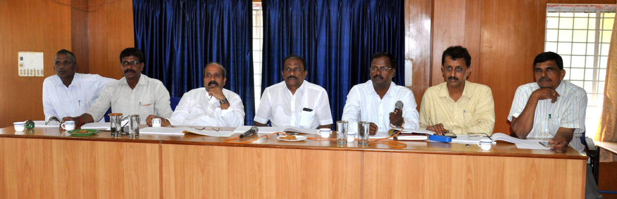MLA Raghupathi Bhat (3rd from left) addresses the quarterly KDP meeting of the Udupi Taluk Panchayat on Tuesday.