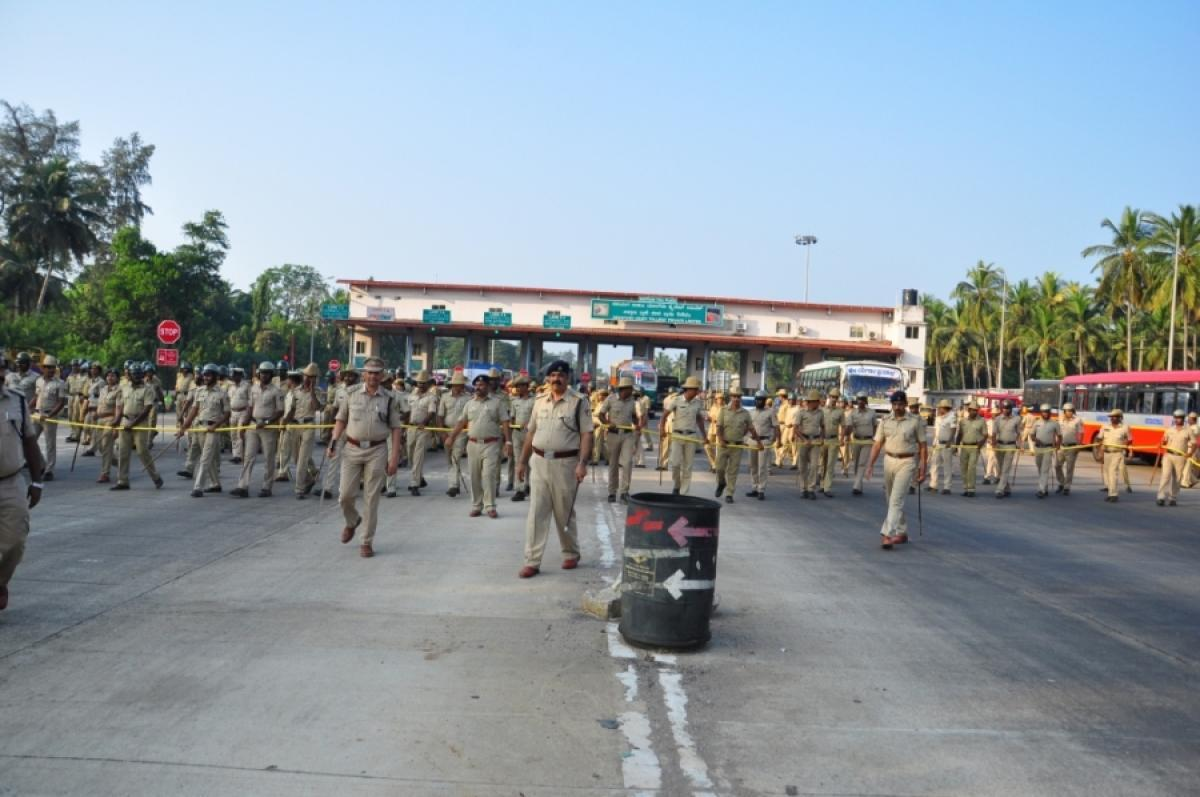 Police personnel deployed at Sasthana tollgate in Udupi district.