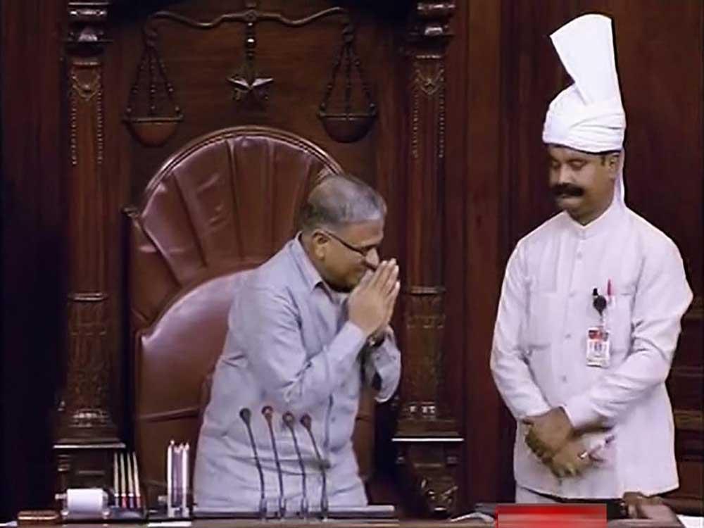 Newly-elected Deputy Chairman of Rajya Sabha Harivansh Narayan Singh greets the house during the Monsoon session of Parliament, in New Delhi. PTI photo