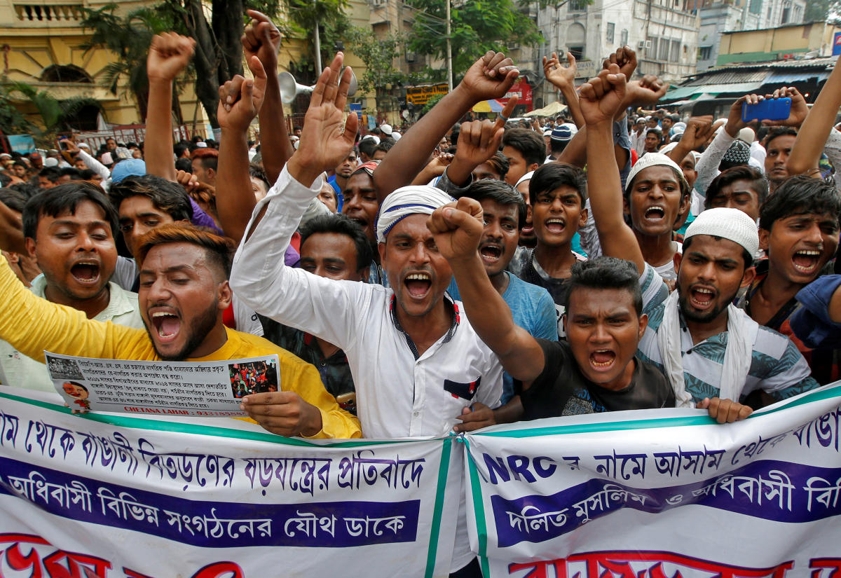 People shout slogans during a protest against what they say is the draft list of the National Register of Citizens (NRC) in the northeastern state of Assam. Reuters file photo
