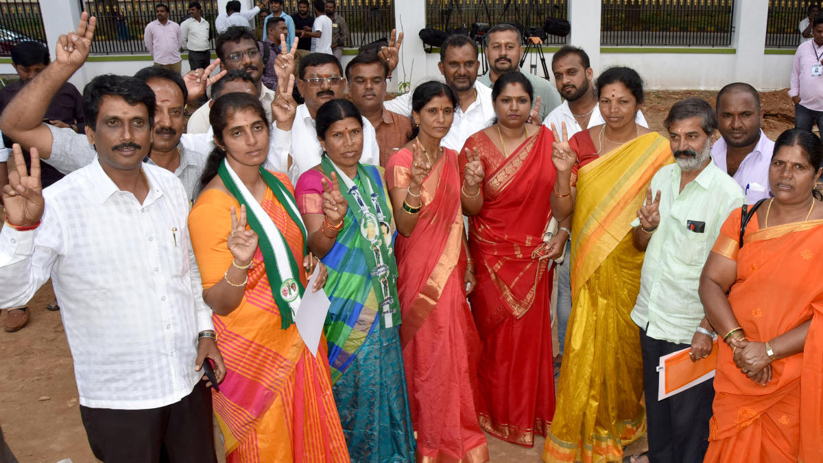 JDS winning candidates celebrating during the MCC election counting at New Maharani's in Mysuru on Monday.