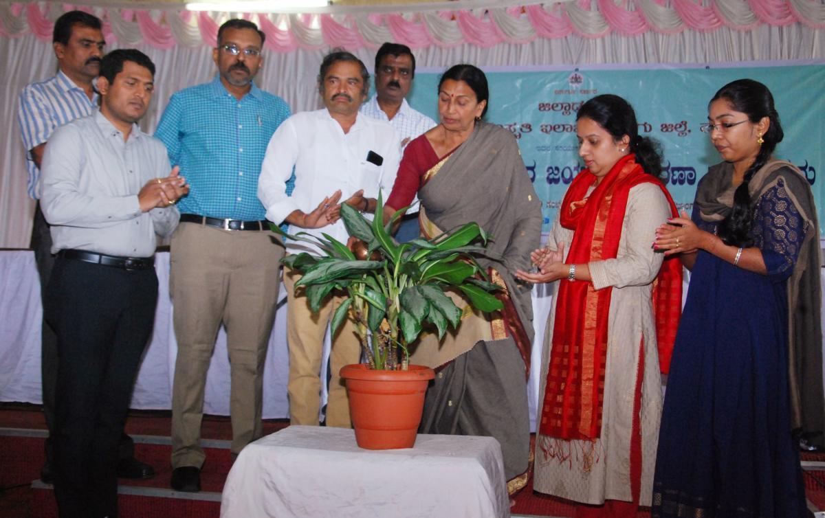 City Municipal Council president Kaveramma Somanna inaugurates Tipu Jayanti programme by watering a plant in Madikeri on Saturday.