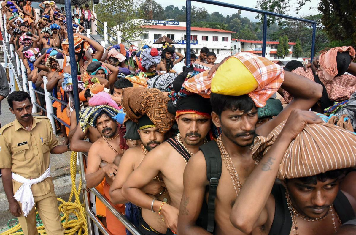 Sabarimala: Devotees queue up to offer prayers at Lord Ayyappa temple during the Malayalam month of 'Vrischikom,' in Sabarimala, Tuesday, Nov. 20, 2018. (PTI Photo) (PTI11_20_2018_000223B)