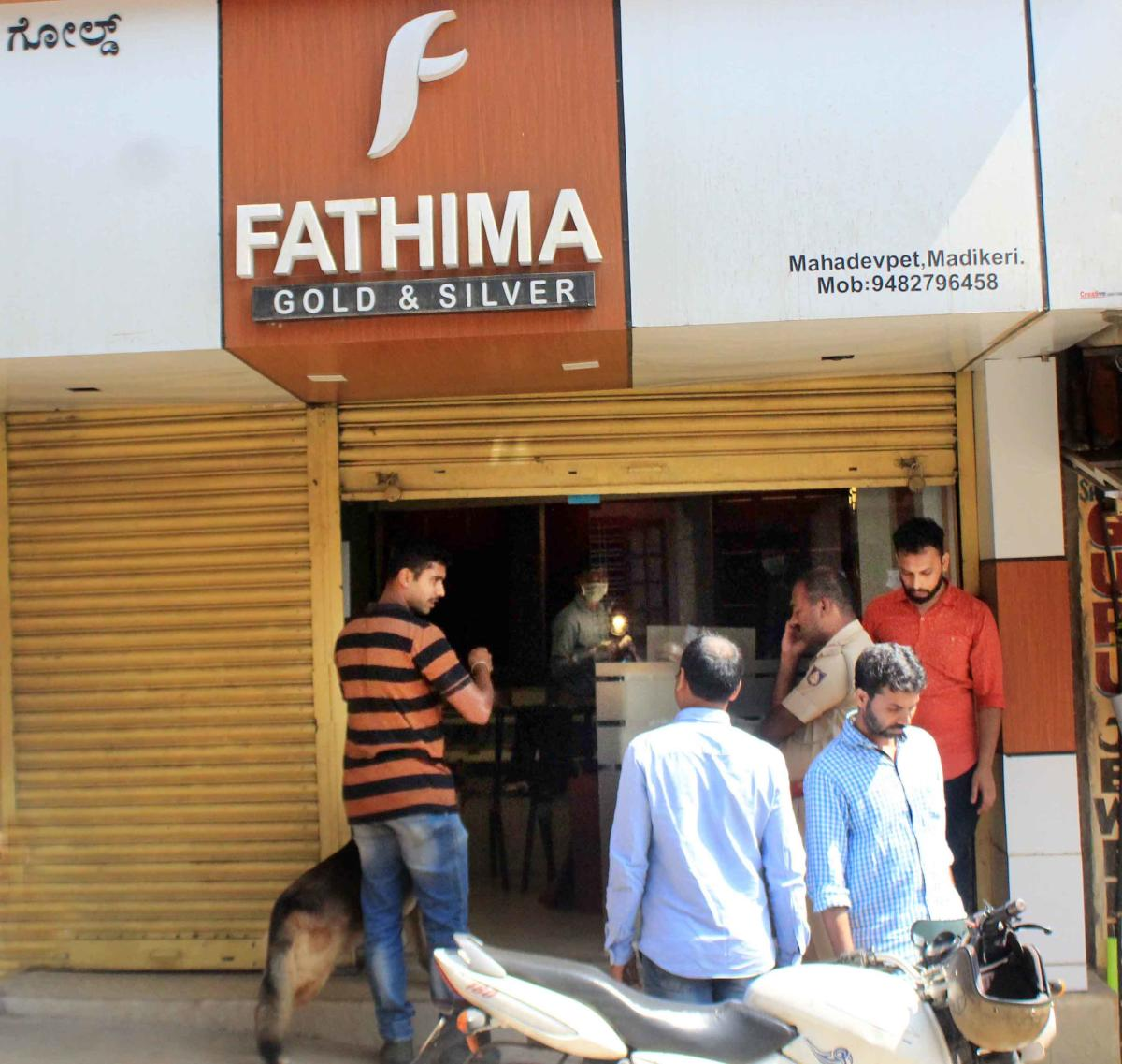 A dog squad and fingerprint experts inspect 'Fathima Gold and Silver' jewellery shop in Madikeri.