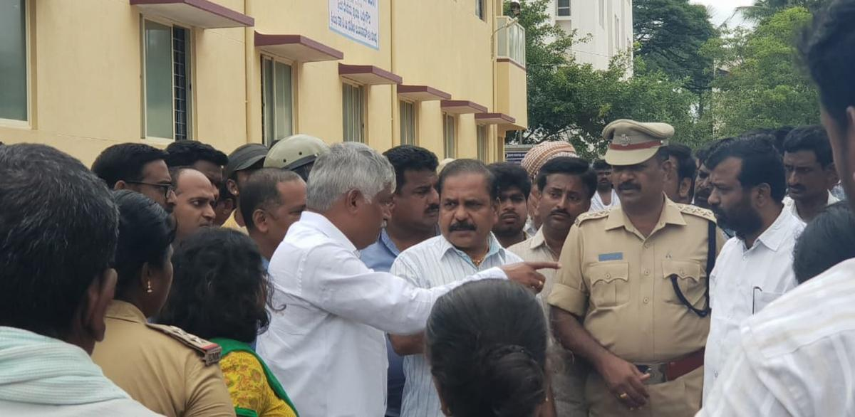 District In-charge Minister C S Puttaraju speaks to MIMS officials in Mandya on Sunday.