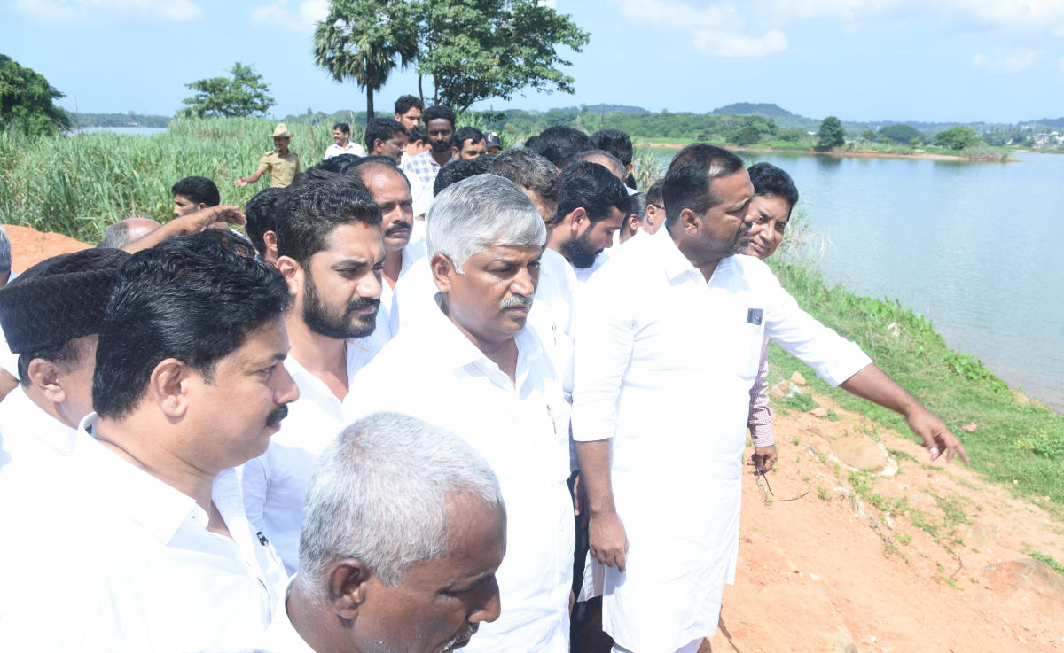 Minor Irrigation Minister C S Puttaraju and District In-Charge Minister U T Khader inspect the spot for the construction of a barrage-cum-bridge across River Nethravathi at Harekala on Friday.
