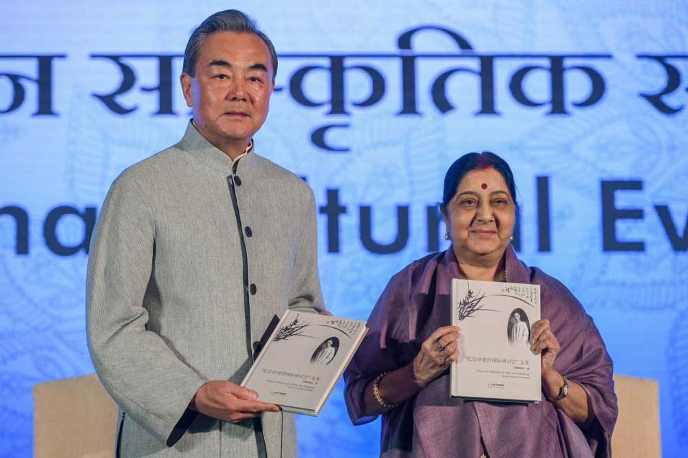 Union External Affairs Minister Sushma Swaraj and her Chinese counterpart Wang Yi release a book during the India-China Cultural Evening, at Pravasi Bhartiya Kendra in New Delhi. PTI Photo