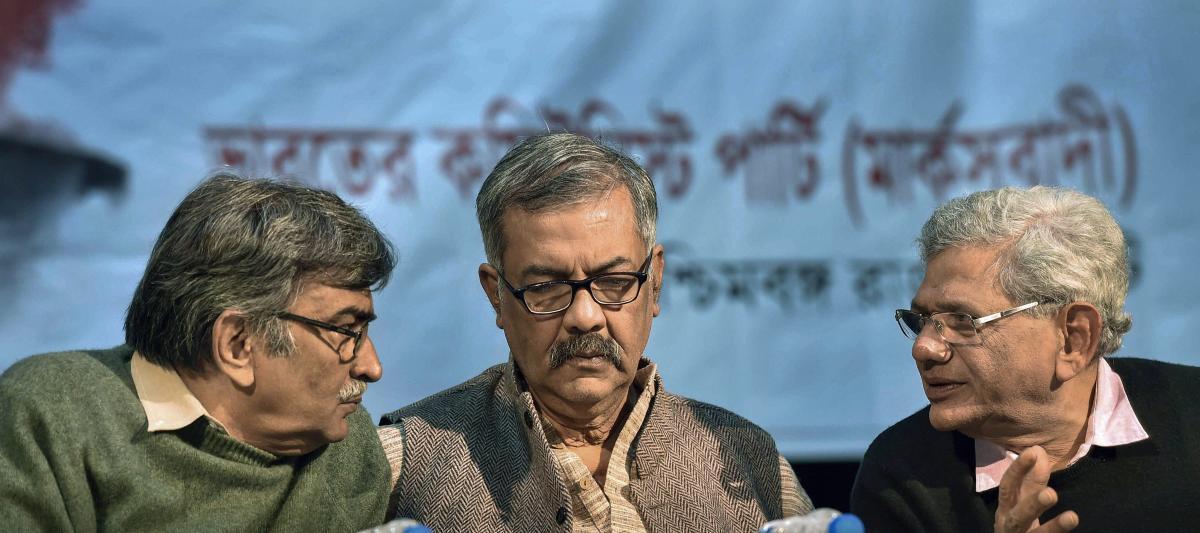 CPM General Secretary Sitaram Yechury (R) with party leaders Surya Kanta Mishra (L) and Nilotpal Basu during ongoing 200th birth anniversary celebrations of Karl Marx, in Kolkata, on Sunday. PTI