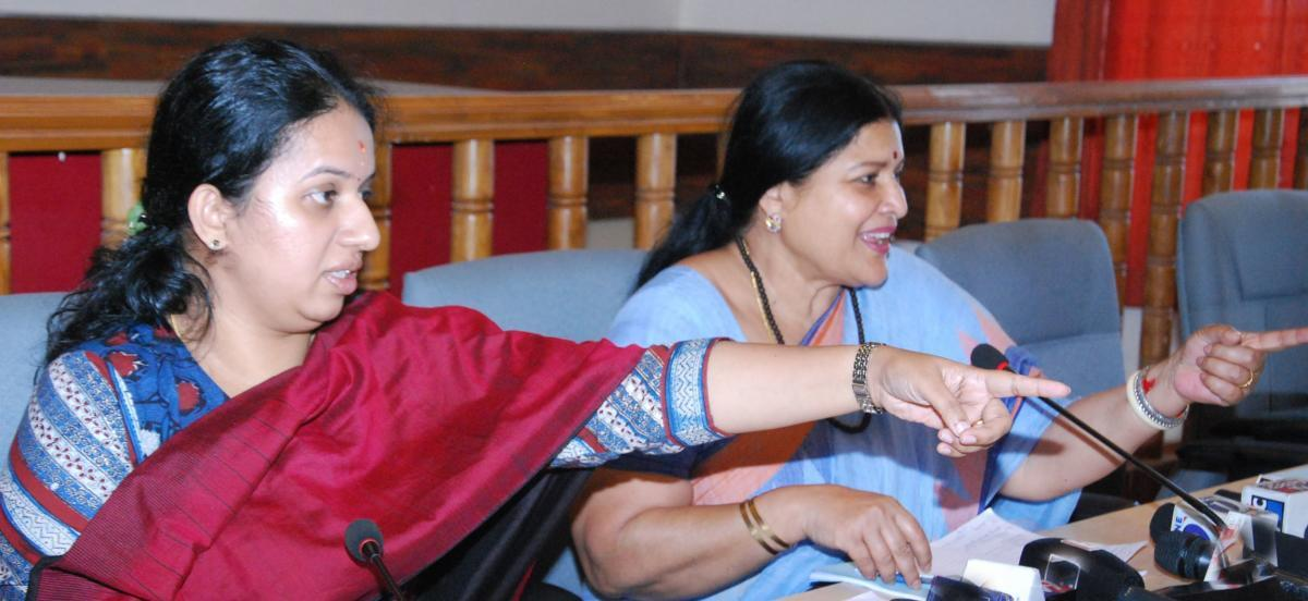 Women and Child Welfare and Kannada and Culture Department Minister Jayamala speaks during the progress review meeting at the DC's office in Madikeri on Monday. Deputy Commissioner P I Sreevidya is also seen.