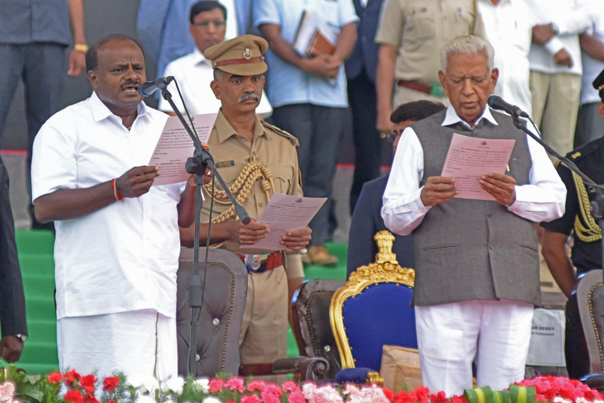 Governor Vajubhai Vala swears in H D Kumarswamy as chief minister of the JD(S)-Congress coalition government.