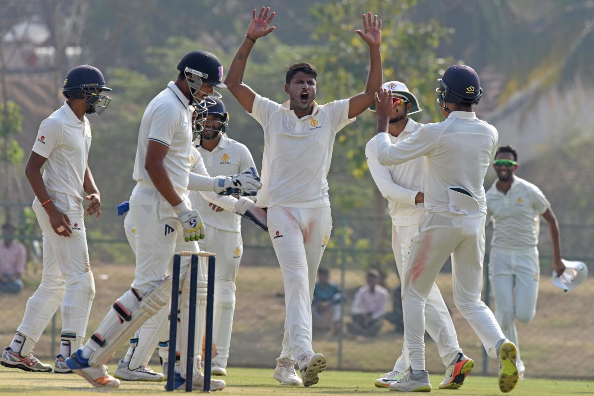 TIMELY: K Gowtham (centre) of Karnataka celebrates after claiming another Railways' wicket in the Ranji Trophy match in Shivamogga on Tuesday. DH Photo/ S K Dinesh