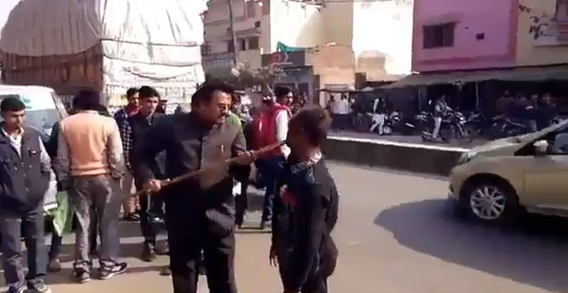 In the video, the local BJP leader, Mohammad Miya, purportedly assaults the man who was shouting that he would vote for Samajwadi Party chief Akhilesh Yadav. (Screengrab)