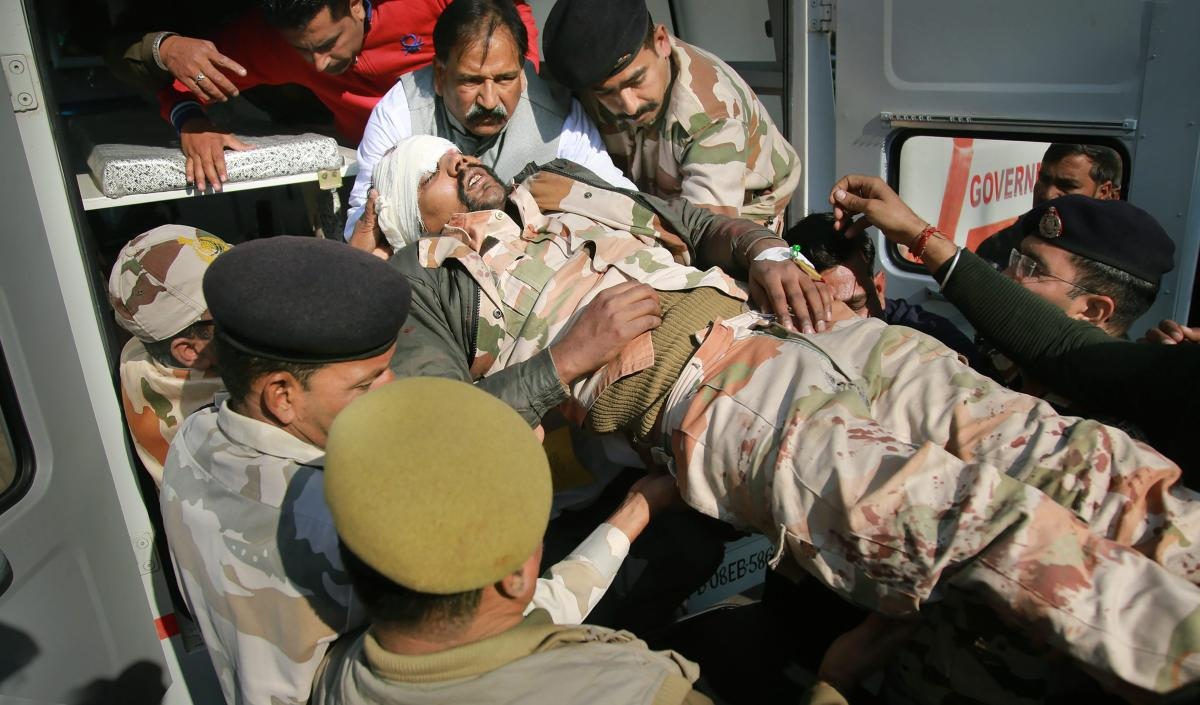 An ITBP jawan who was injured in a road accident being shifted to a hospital in Jammu, Monday, Dec. 24, 2018 (PTI Photo)