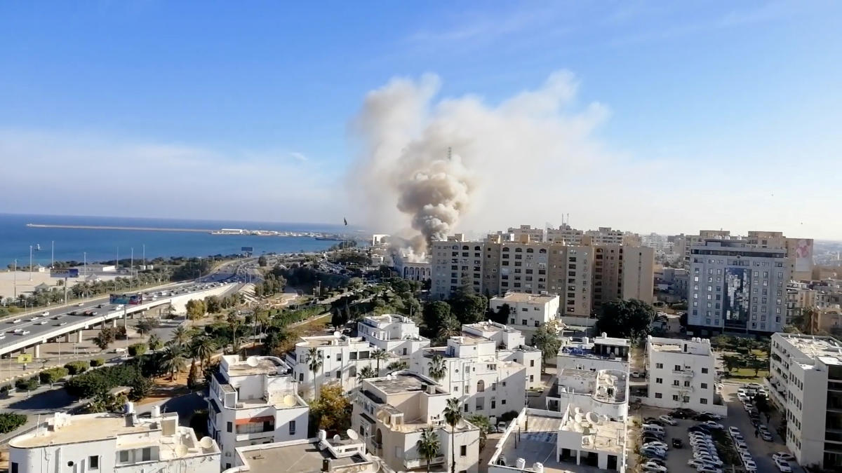 Smoke rises from the Libyan foreign ministry building in Tripoli, Libya December 25, 2018, in this still image obtained from a social media video. (Youtube/Mohammed Elgotani/via REUTERS)