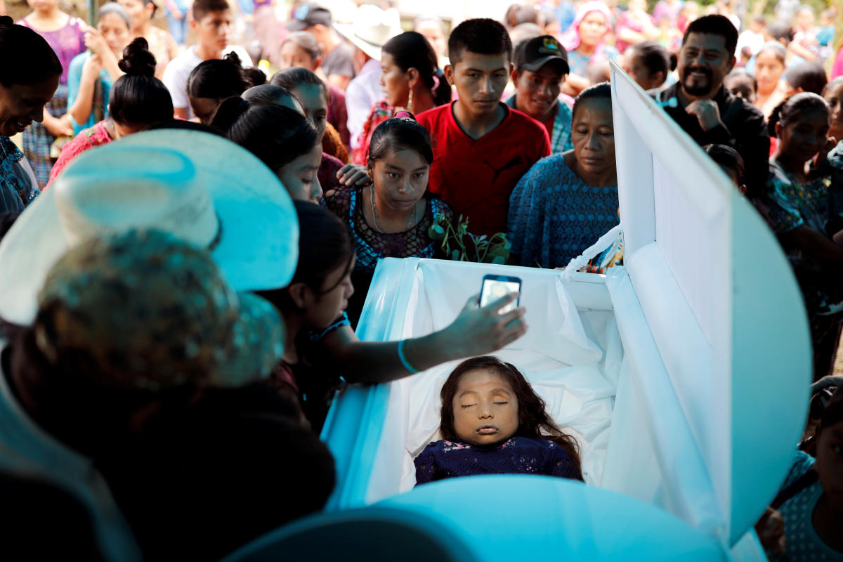 Friends and family gather around the coffin of Jakelin Caal, a 7-year-old girl who handed herself in to US border agents earlier this month and died after developing a high fever while in the custody of US Customs and Border Protection, during her funeral